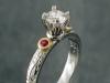 Platinum diamond ring with rubies.