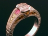 Emerald cut diamond ring with pink and yellow diamonds