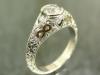 Diamond ring with 24K inlaid infinity symbols