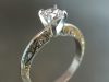 Diamond solitaire with 24K inlay