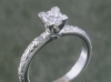 Princess cut in platinum solitaire with hand engraving.