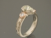 Pear shaped diamond ring in white gold woith rose gold accent settings