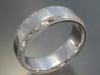 Beveled edge band with hand engraved border