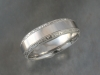 Palladium band with hand engraved beveled edge.
