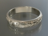 14K 4mm band engraved with holly leaves and berries